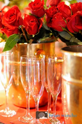 Red roses and champagne glasses. Event photographer in El Paso